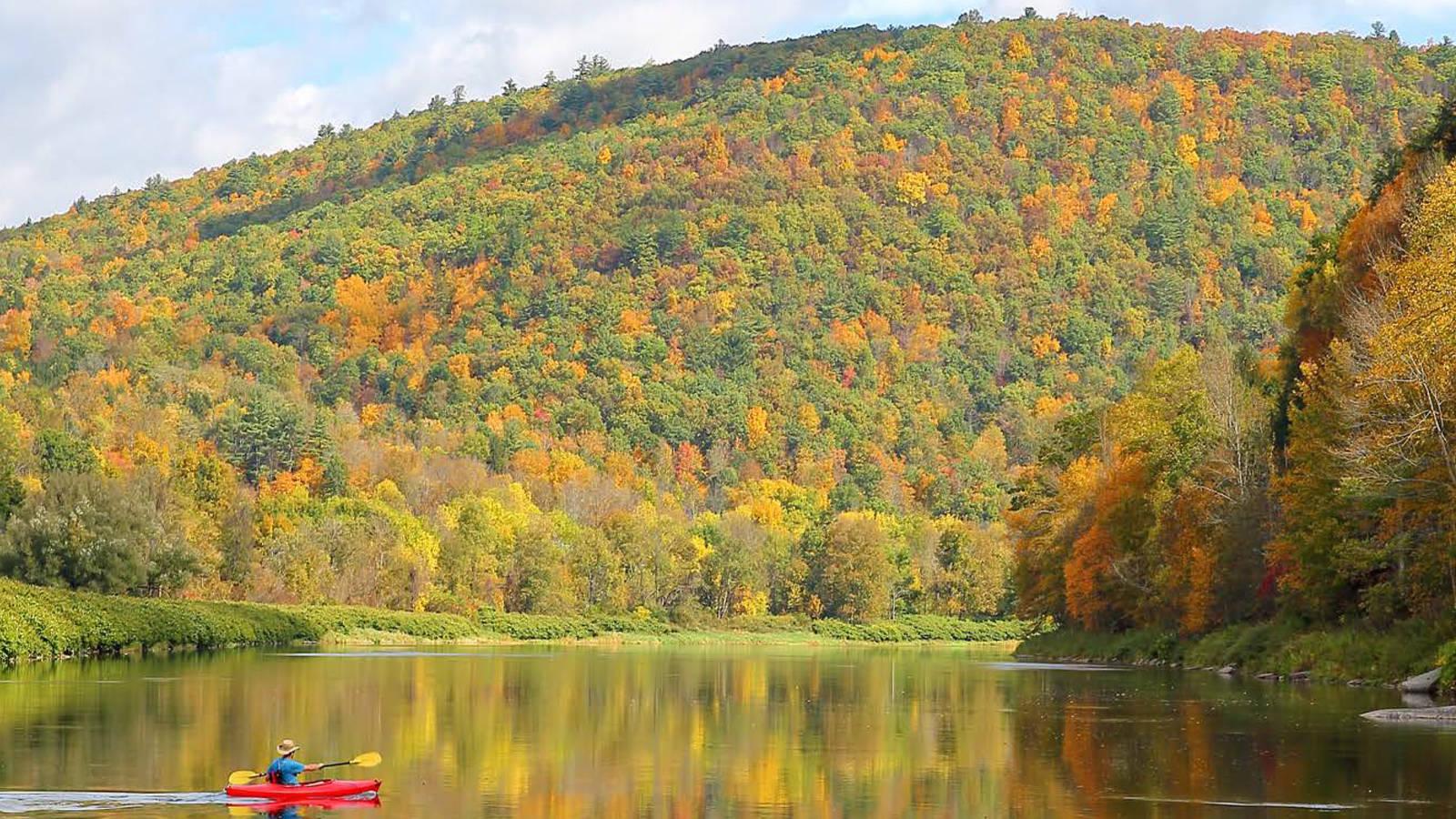 Residents and visitors alike enjoy recreational boating along the Upper Delaware River amidst scenic backdrops like Kilgour Spur.