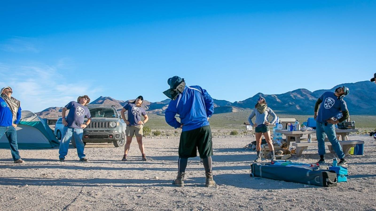 <p>On a trip to Death Valley National Park, veterans take part in some mindful movement, including yoga stretches.</p>