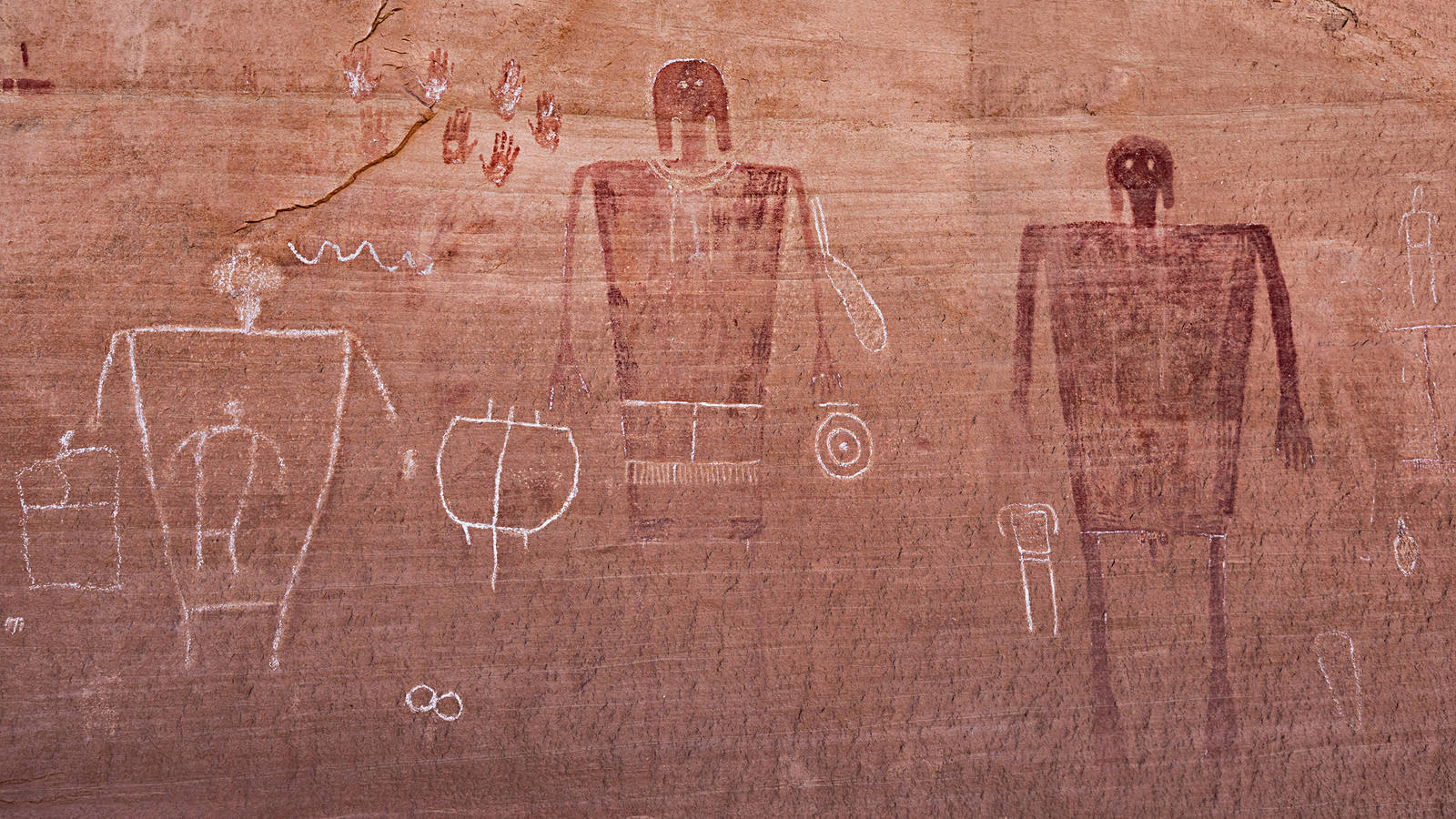 """<h3 style=""""text-align: center; padding: 50px;""""><span class=""""text-Intro-style"""">The Big Man Panel, located in Bears Ears, features reddish pictographs of human figures. <br />Visitors traced faint petroglyphs with chalk.<br />© STEPHEN ALVAREZ</span></h3>"""