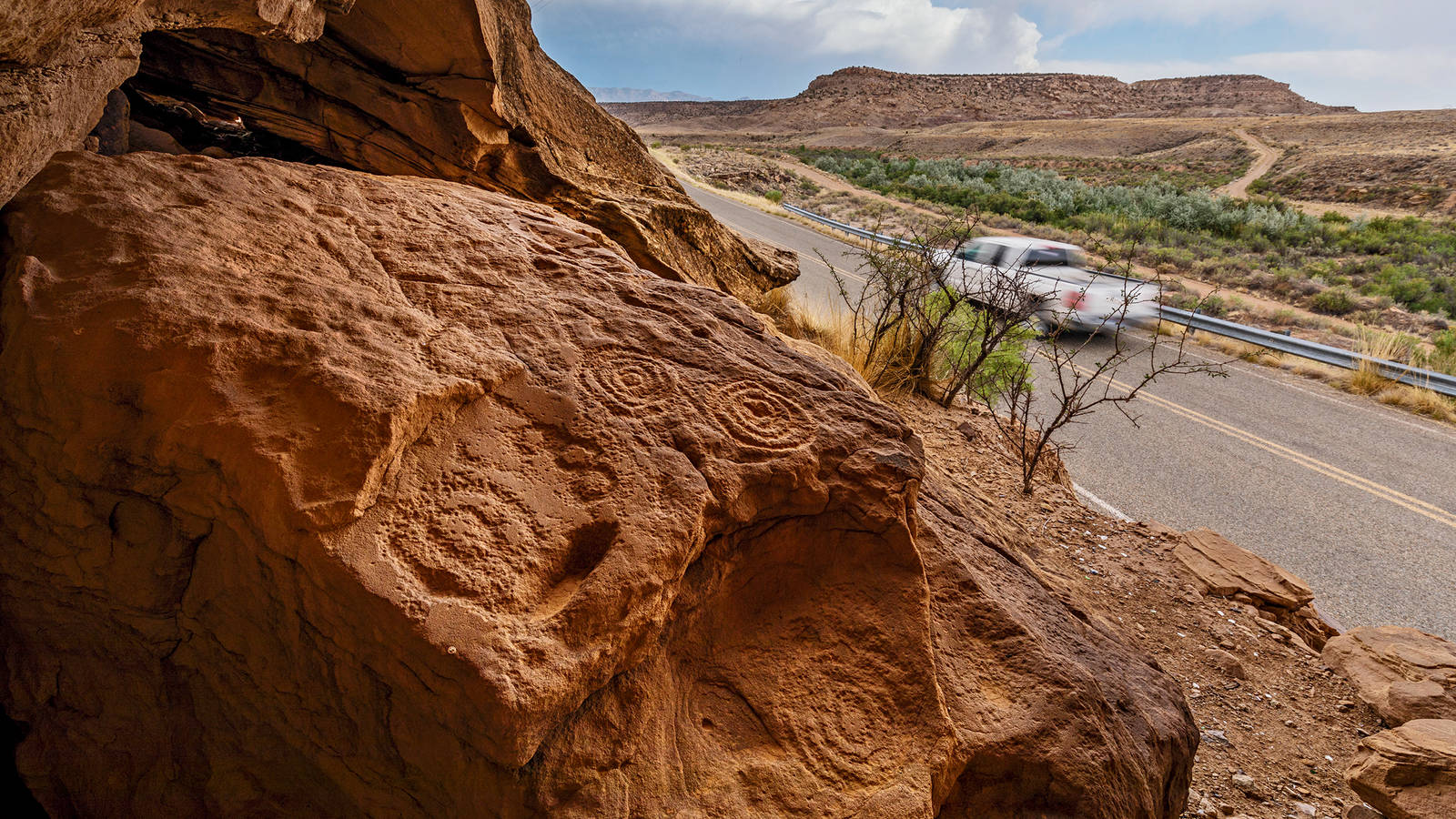"""<h3 style=""""text-align: center; padding: 50px;""""><span class=""""text-Intro-style"""">On the edge of Canyons of the Ancients National Monument in southwestern Colorado, an engraved boulder sits very close to the road, leaving it vulnerable to vandalism and plunder. © STEPHEN ALVAREZ</span></h3>"""