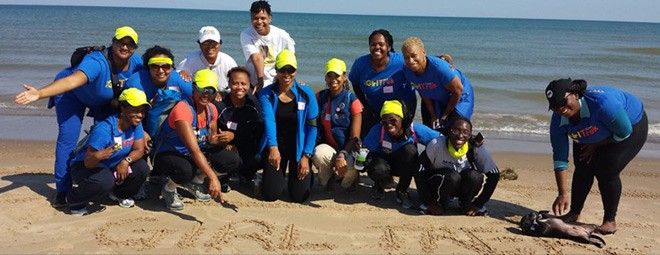 The women of GirlTrek end their hike by enjoying the beach at Indiana Dunes last month. Photo courtesy of Sandria M. Washington.