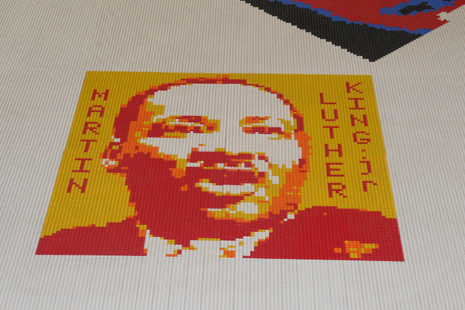 It's powerful. Is it appropriate? Martin Luther King, Jr.'s portrait, made of toy building blocks, on the floor of a jail cell, in the @Large exhibit.