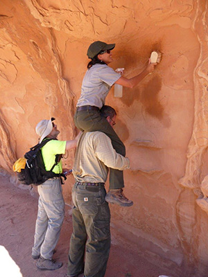 Volunteers remove graffiti at Arches National Park as part of last year's National Public Lands Day.