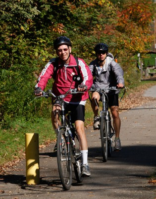 Bicyclists enjoy the smooth paved Erie to Pittsburgh Trail within the Oil Region National Heritage Area. Photo © Heather Mull.