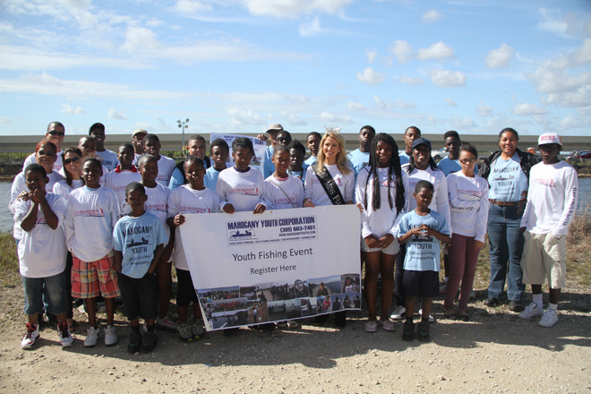 Mahogany Youth students and mentors pose with NPCA staff and Miss Florida, Laura McKeeman.