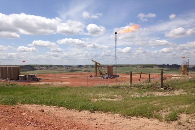 This well pad is burning off natural gas into the air, creating a flare. Flares like this one, within a mile of the North Unit of the park, contribute to air pollution and are visible at night.