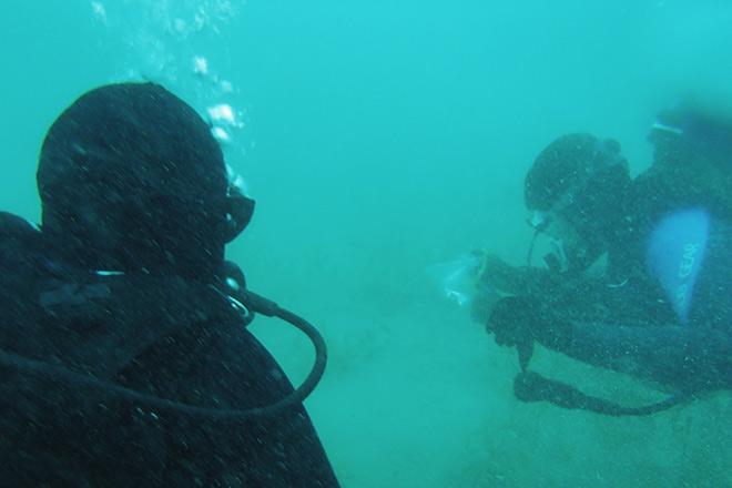 Volunteer divers in Lake Michigan.