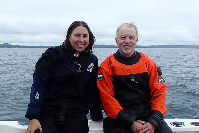 Volunteer divers Deb Smith and Ken Holzman join Emily in a dive to count invasive round goby fish, and to collect samples of algae and invasive quagga mussels.