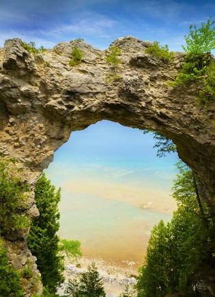 The view of Lake Huron through Arch Rock, one of the best-known features of Mackinac Island.