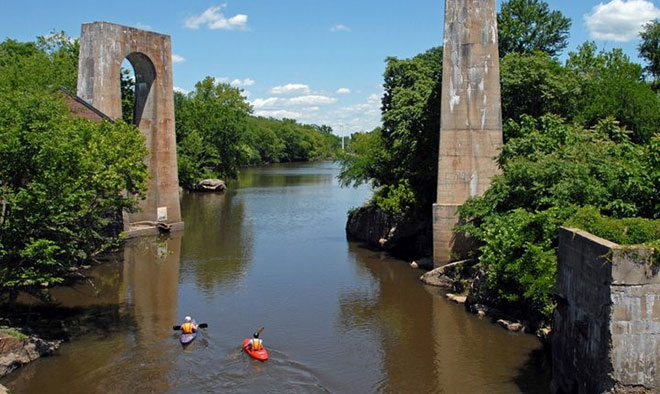 Paddlers on the Appomattox River pass through a previously dammed stretch of river.