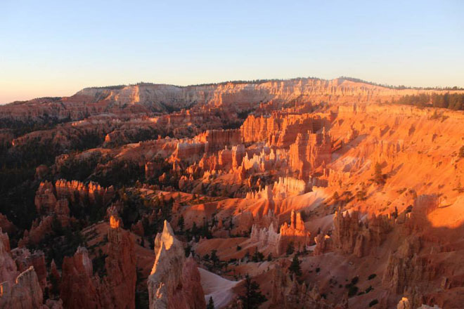 Sunrise is one of the best times to see the range of colors at Bryce Canyon.
