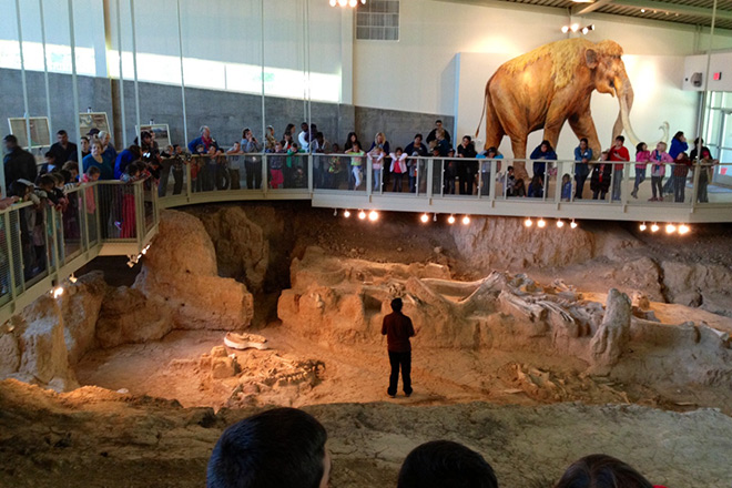 A guide shares information with a tour group at the new Waco Mammoth National Monument. Photo © NPCA.